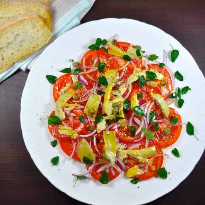 Tomato and Artichoke Salad - this takes mere minutes to prepare and you won't believe how incredible the flavour of the tomatoes are. Easily adaptable to whatever you have on hand, just use this recipe as a guide.