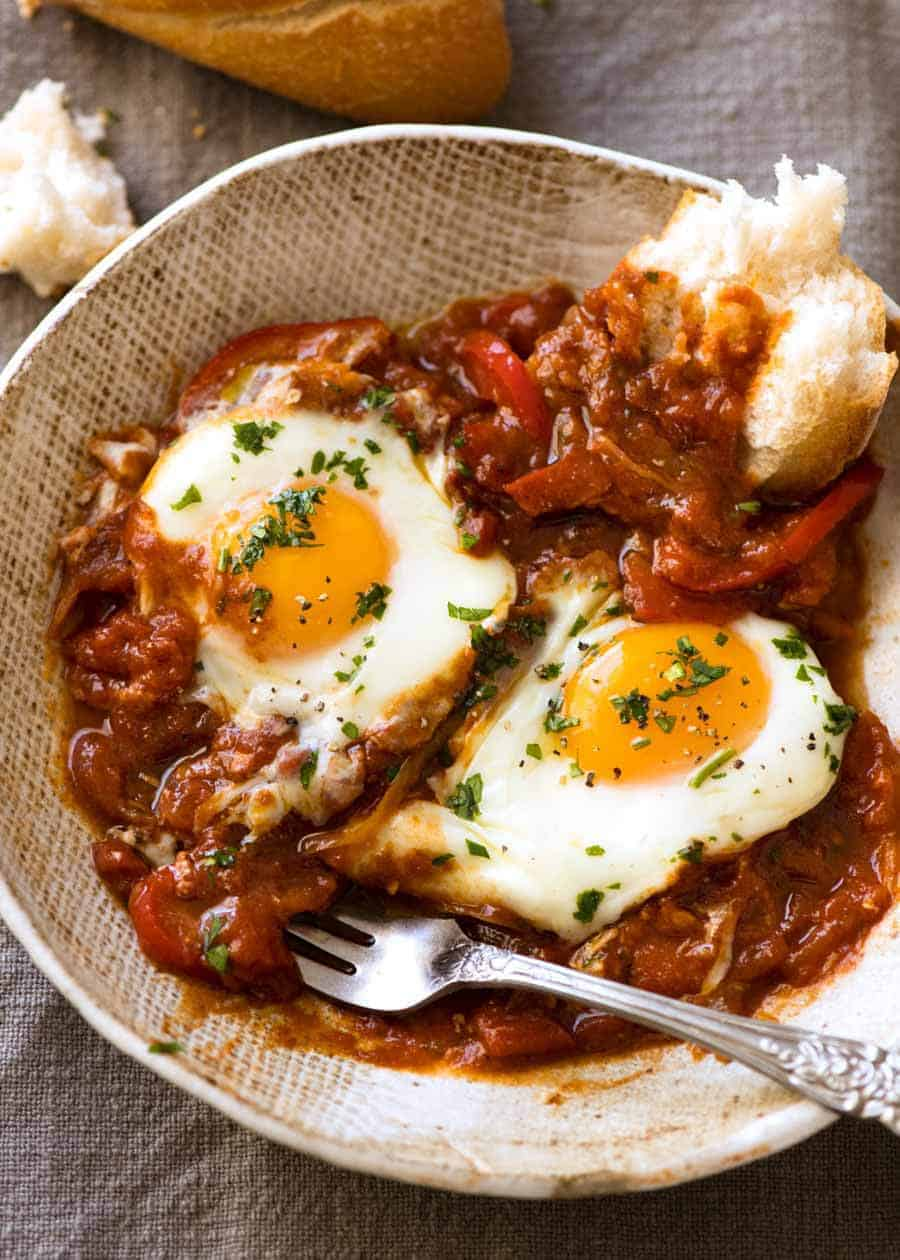 Shakshuka - Middle Eastern baked eggs in a bowl, ready to be eaten
