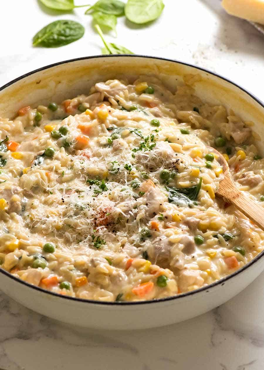 Creamy Chicken Vegetable Risoni in a white skillet, fresh off the stove. Quick chicken dinner recipe!