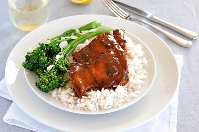 A whole meal in 15 min! The glaze is made using pantry ingredients, and there's a nifty tip to steam the broccolini with the resting rice!