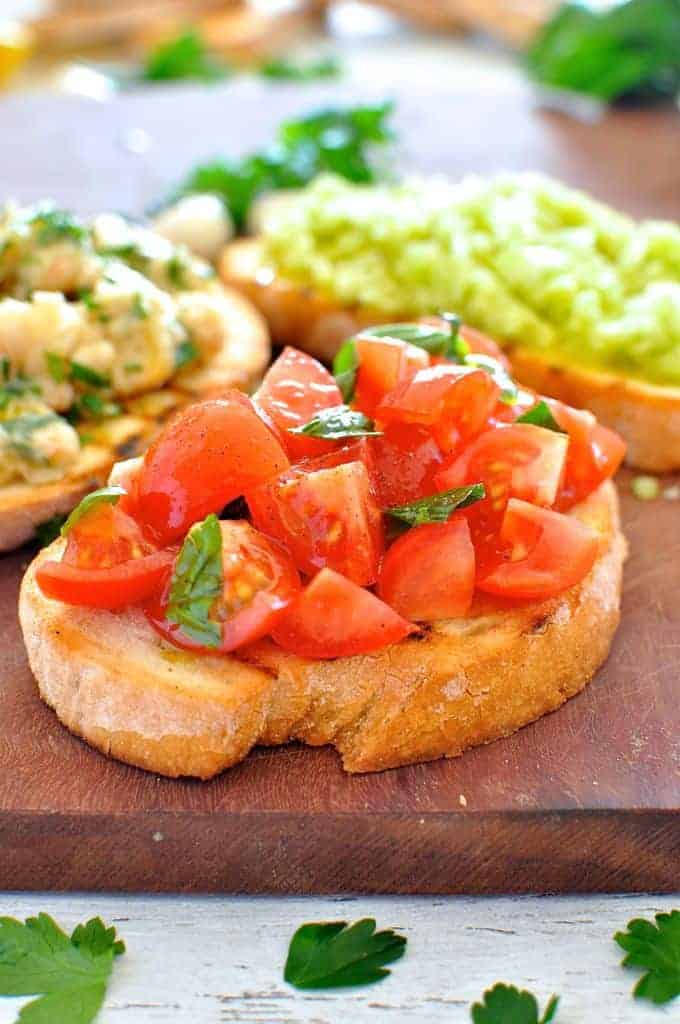 Tomato & Basil, Lemon Cannellini and a refreshing Celery Lime Bruschetta spread. Classic Italian toppings.