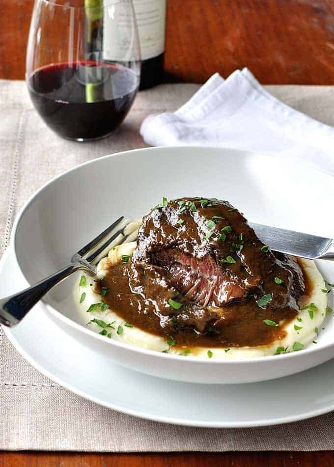 Unbelievably tender with a thick sauce made from the braising liquid. SO EASY. Directions for slow cooker, oven and stovetop. #crockpot #braised