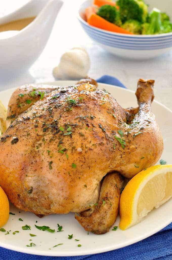 5 minutes prep for an incredibly juicy roast chicken plus the secret to a great gravy. #crockpot #whole #chicken #whole_chicken