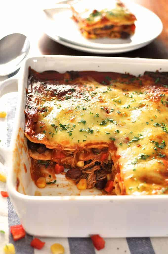 10 minutes to assemble, it's an enchilada - layered up like lasagna! Great for freezing, either before or after baking. #enchilada #mexican #lasagna