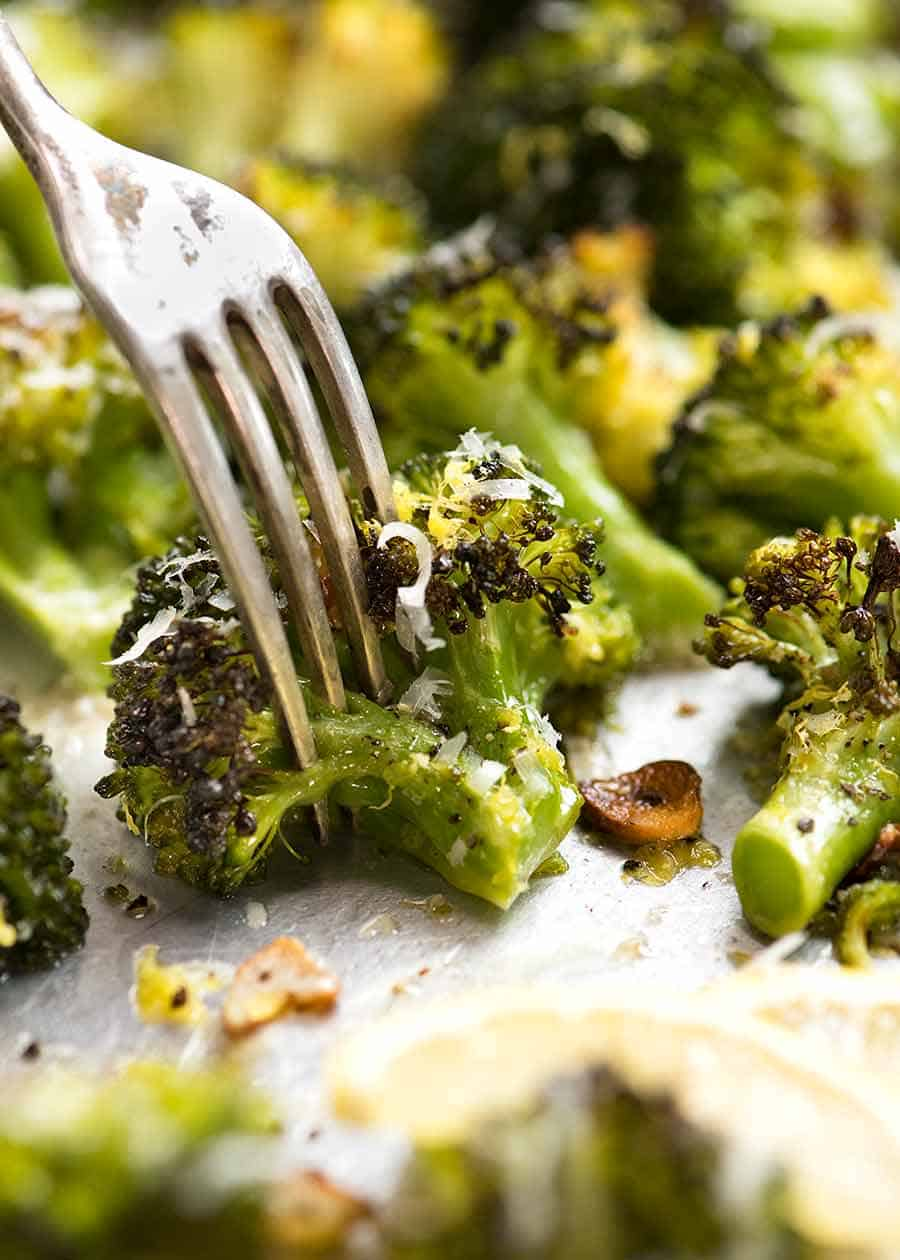 Close up of fork and a piece of Magic Broccoli - the best roasted broccoli ever