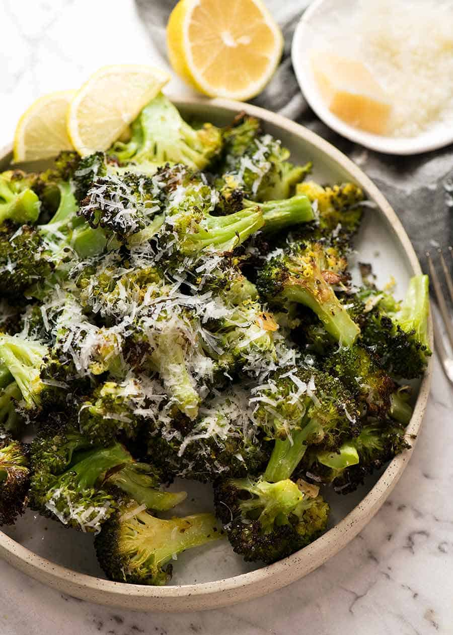 Magic Broccoli - the best roasted broccoli ever - on a white plate, ready for serving