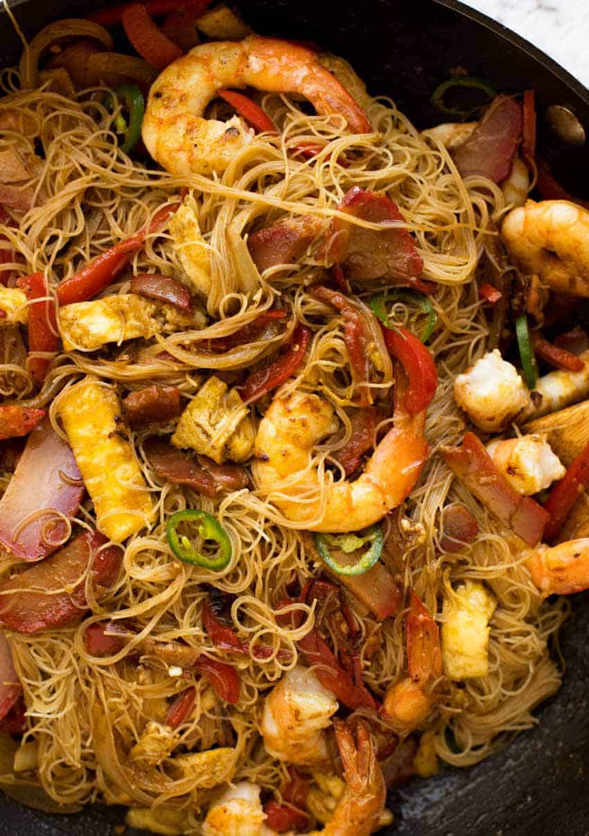 Singapore Noodles in a wok, fresh off the stove, ready to be served.