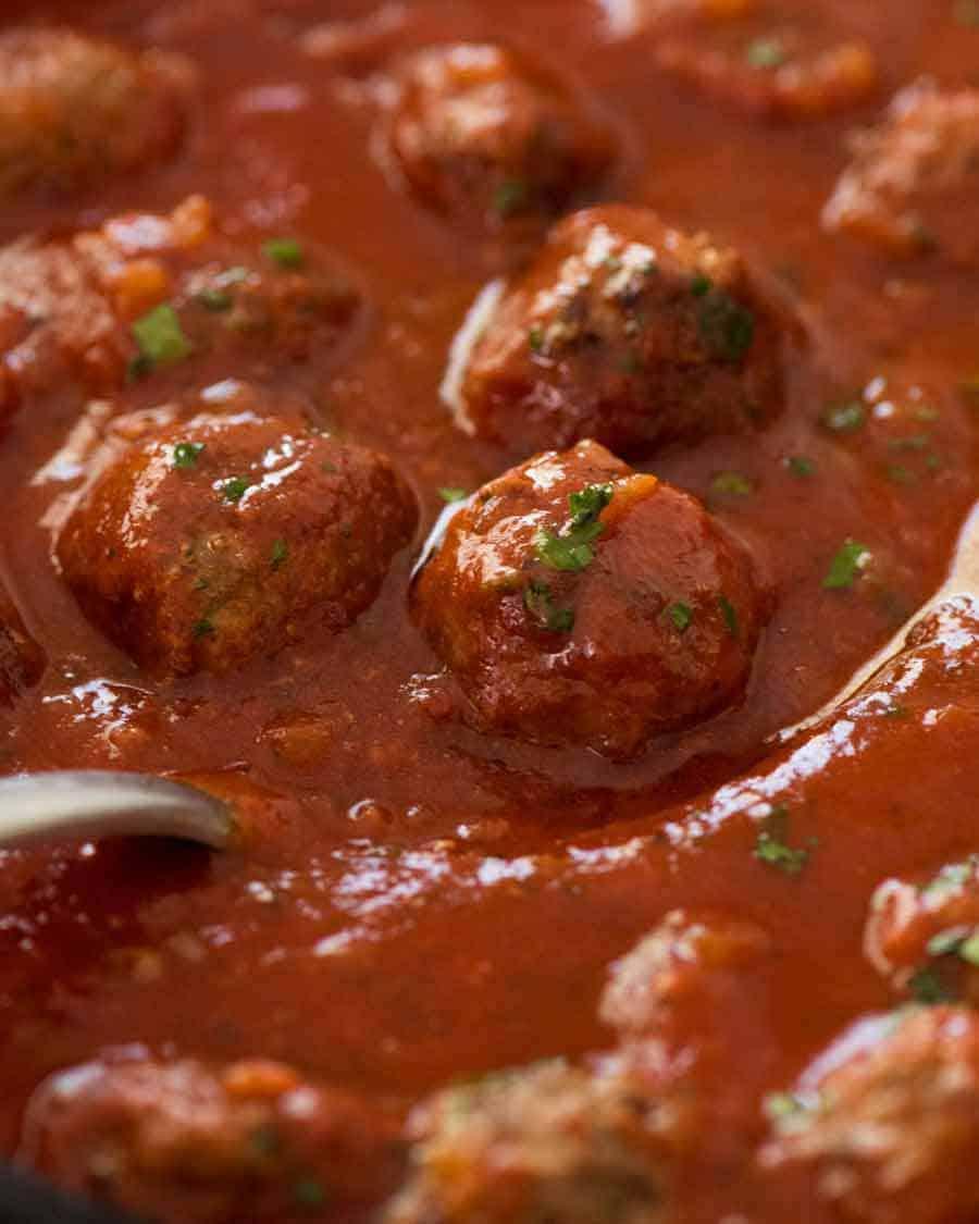 Close up of Italian Meatballs simmering in marinara sauce