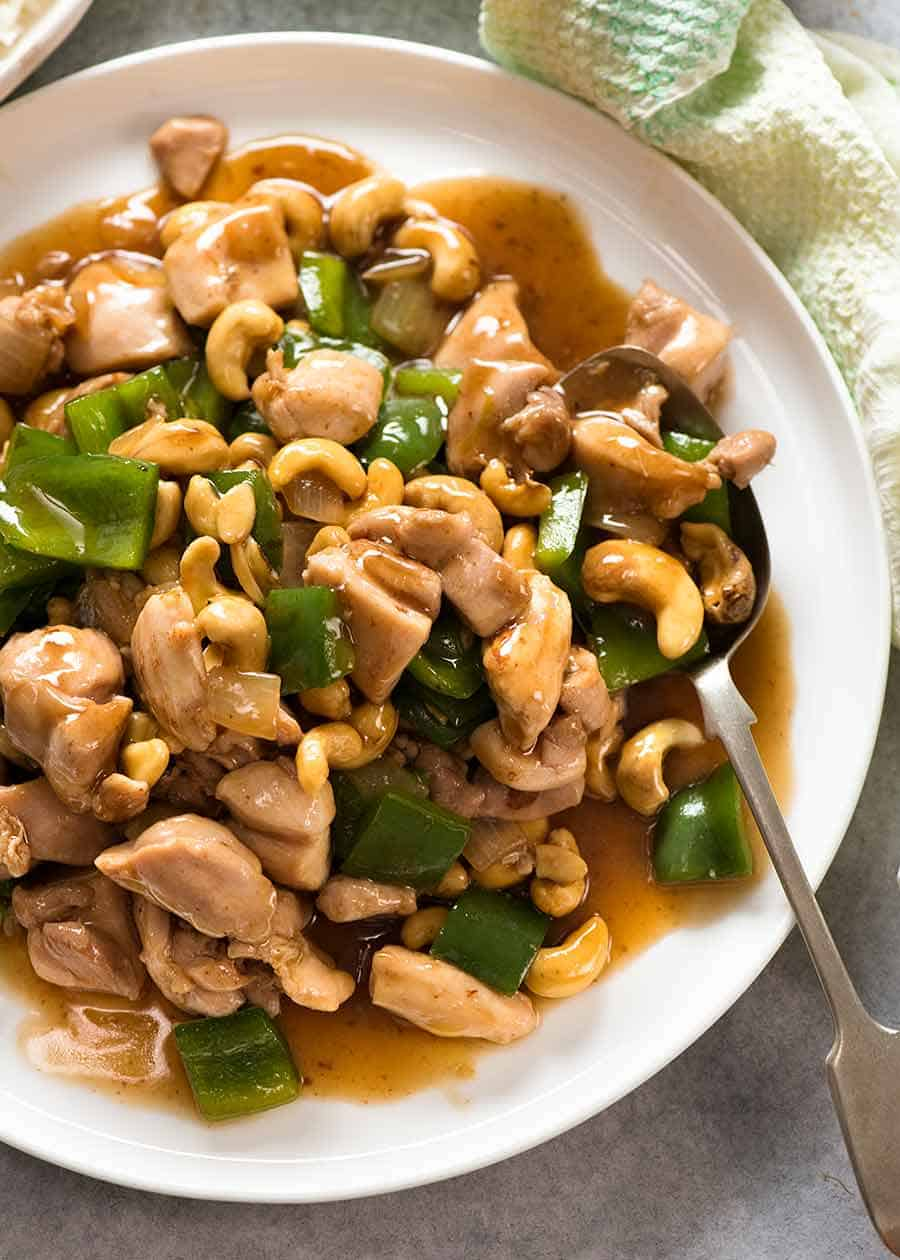 Chinese Cashew Chicken with sauce on a white plate, ready to be served