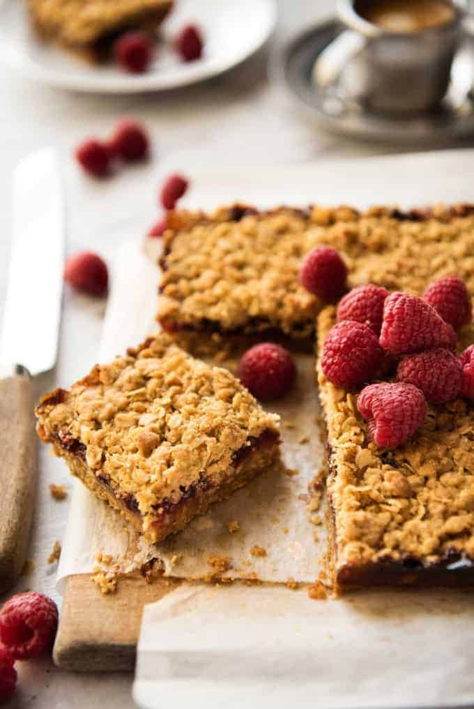 Raspberry Bars - One of the fastest bars to make from scratch, these have an oatmeal biscuit base, raspberry jam and a crumbly oatmeal topping. Just 10 minutes prep! www.recipetineats.com