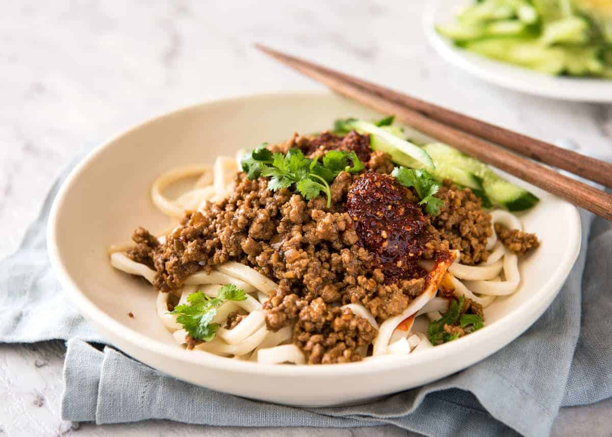 "Chinese Pork with Noodles (Zha Jiang Mian) - Super quick and super tasty, affectionally known as ""Chinese Bolognese"". The pork is savoury with a touch of heat and spice, perfect mixed through noodles! www.recipetineats.com"