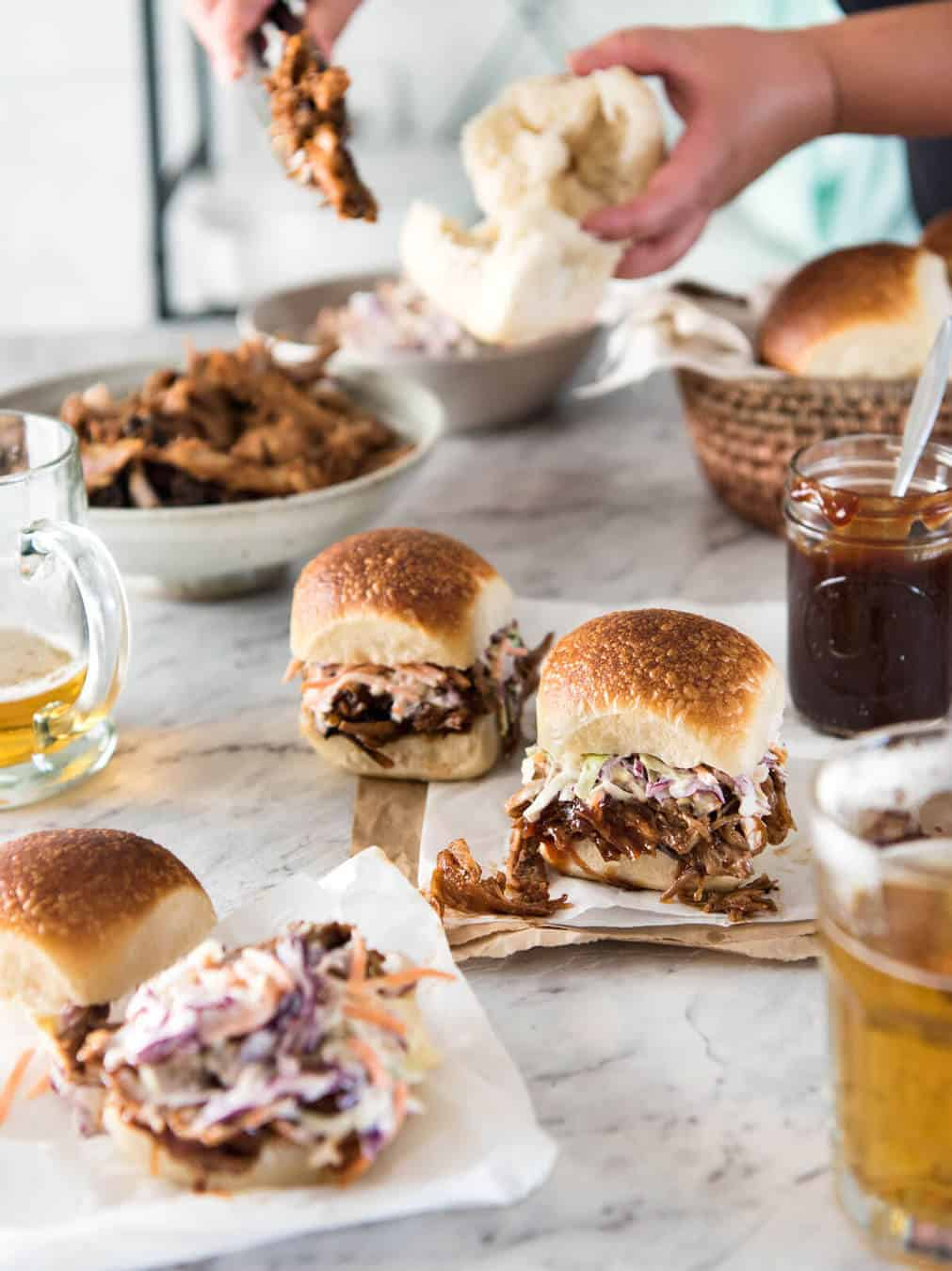 Slow Cooker BBQ Pulled Pork Sandwich - Perfectly seasoned, tender pulled pork tossed in a homemade BBQ sauce, piled onto bread with coleslaw. Slow cooker, pressure cooker or oven. www.recipetineats.com