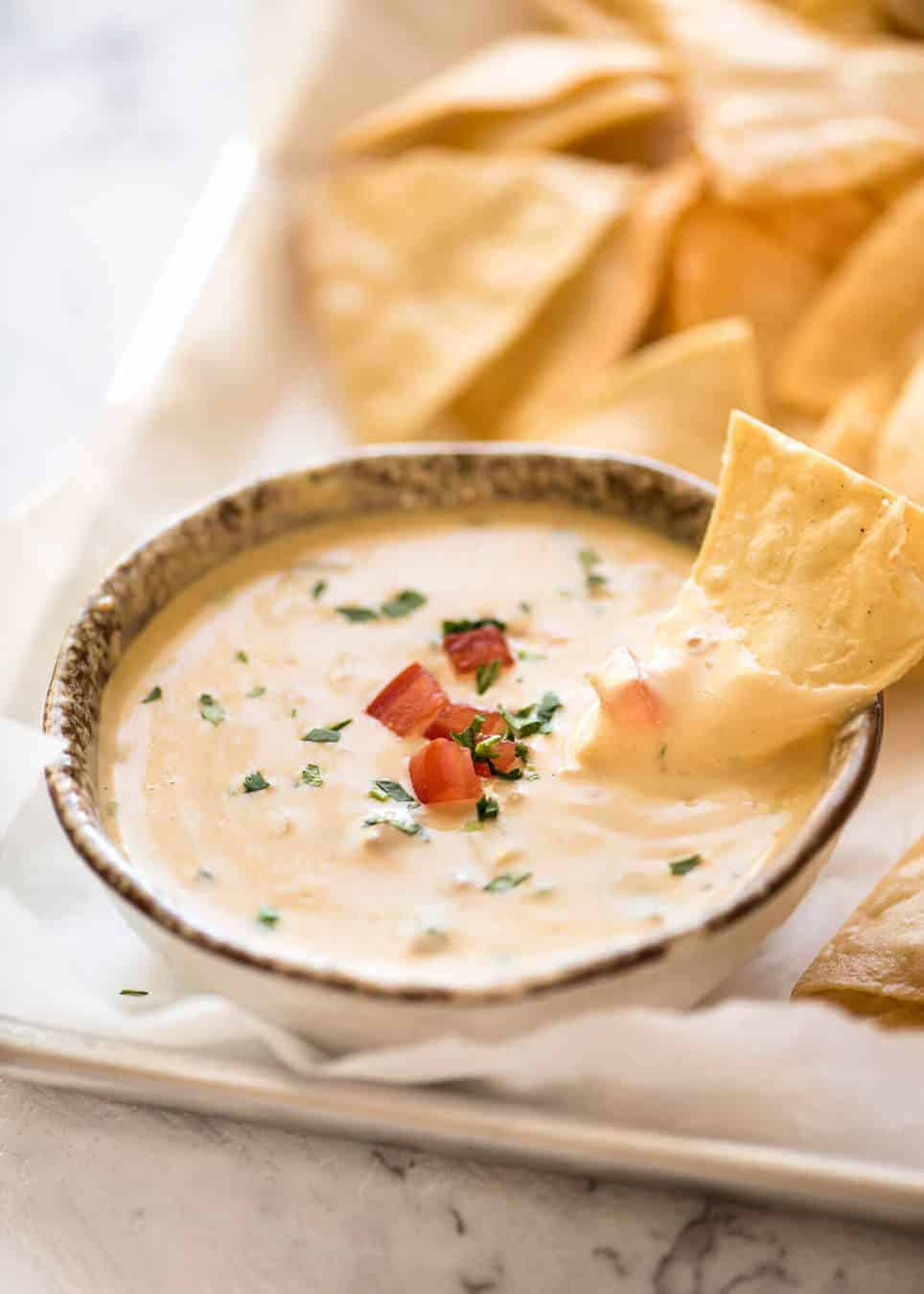 Code cracked: Queso Dip made with real cheese that's ultra silky even when it cools. www.recipetineats.com