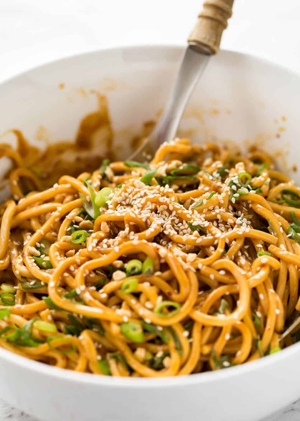 Sesame Noodles - noodles tossed with a wicked Asian Sesame Peanut Dressing. Serve these as Cold Sesame Noodles or warm. www.recipetineats.com