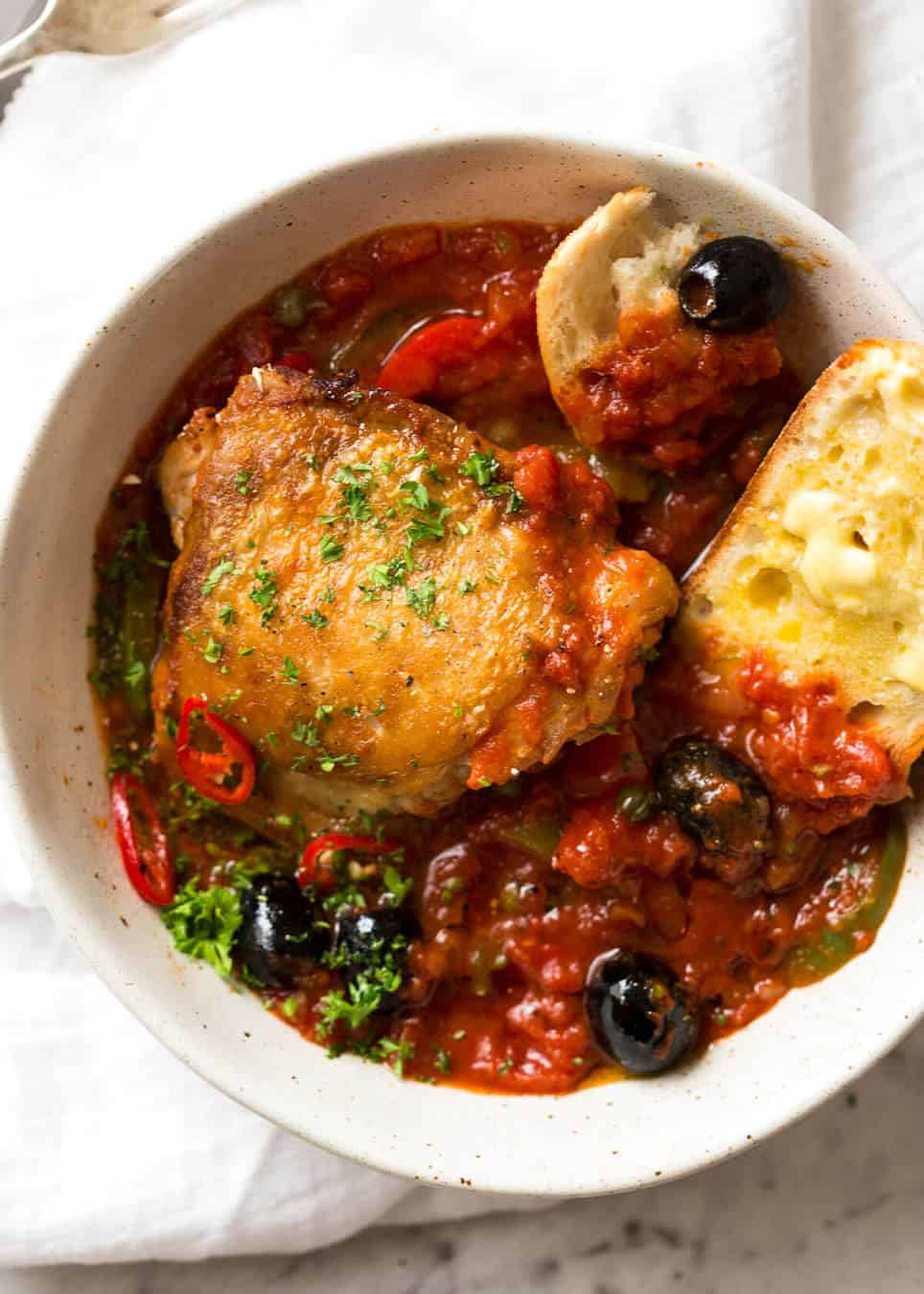 A hearty Italian Chicken Casserole with crispy chicken, capsicum / bell peppers, olives and capers. Sicilian style! www.recipetineats.com