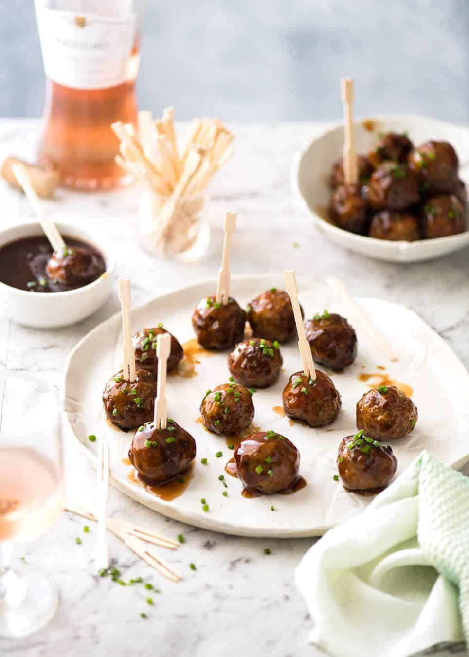 Plump, juicy and soft, these Party Cocktail Meatballs are baked and served with a fabulous Sweet & Sour Dipping Sauce that's super quick to make. Great make ahead for parties! www.recipetineats.com