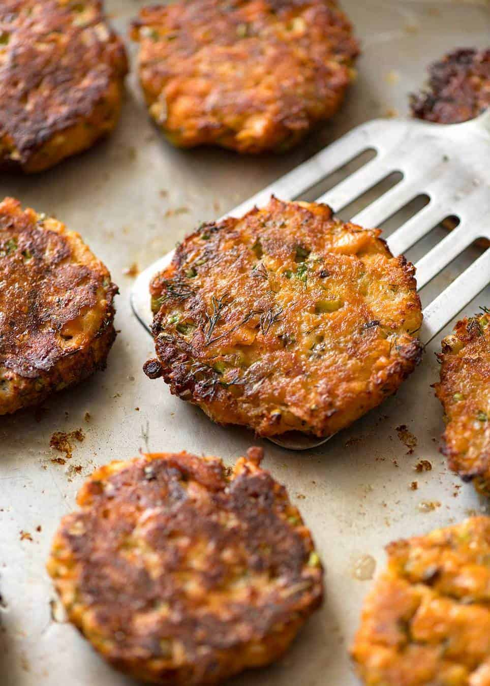 Tender insides studded with flakes of salmon, golden on the outside, these Salmon Patties are baked, not fried. Ultimate transformation of canned salmon - or use fresh! www.recipetineats.com