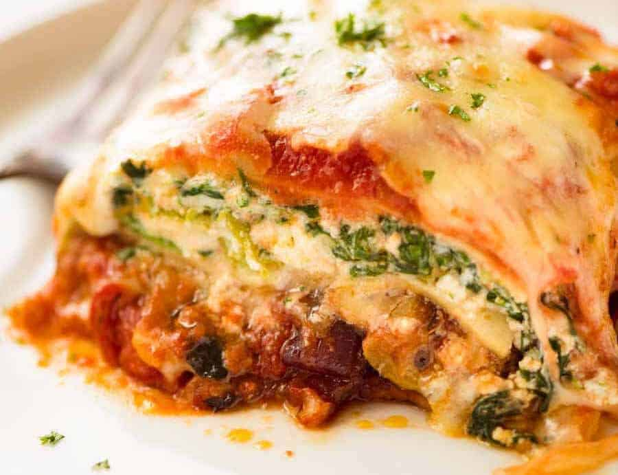 Vegetarian Lasagna on a white plate, ready to be eaten