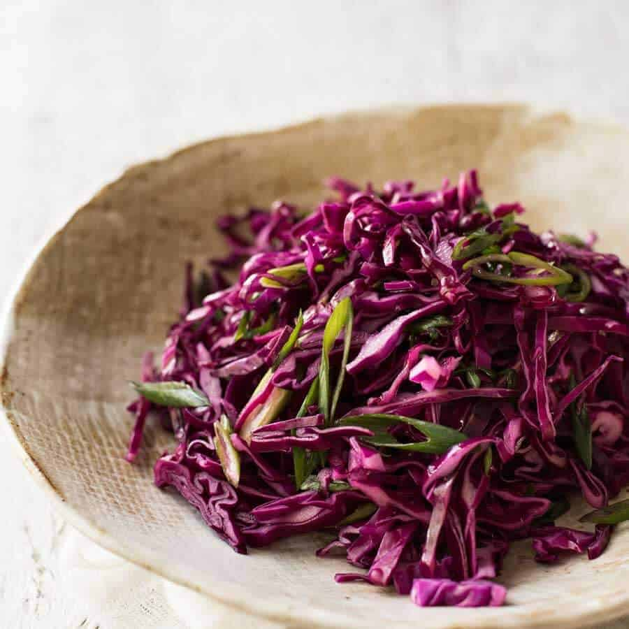 Quick pickled red cabbage - great side for a Mexican menu - in a rustic brown bowl.