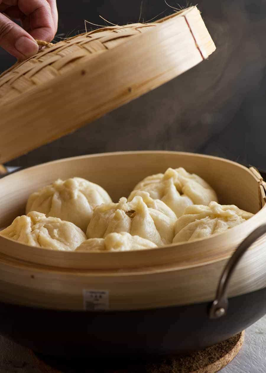 Freshly made Chinese Steamed Pork Buns in a bamboo steamer