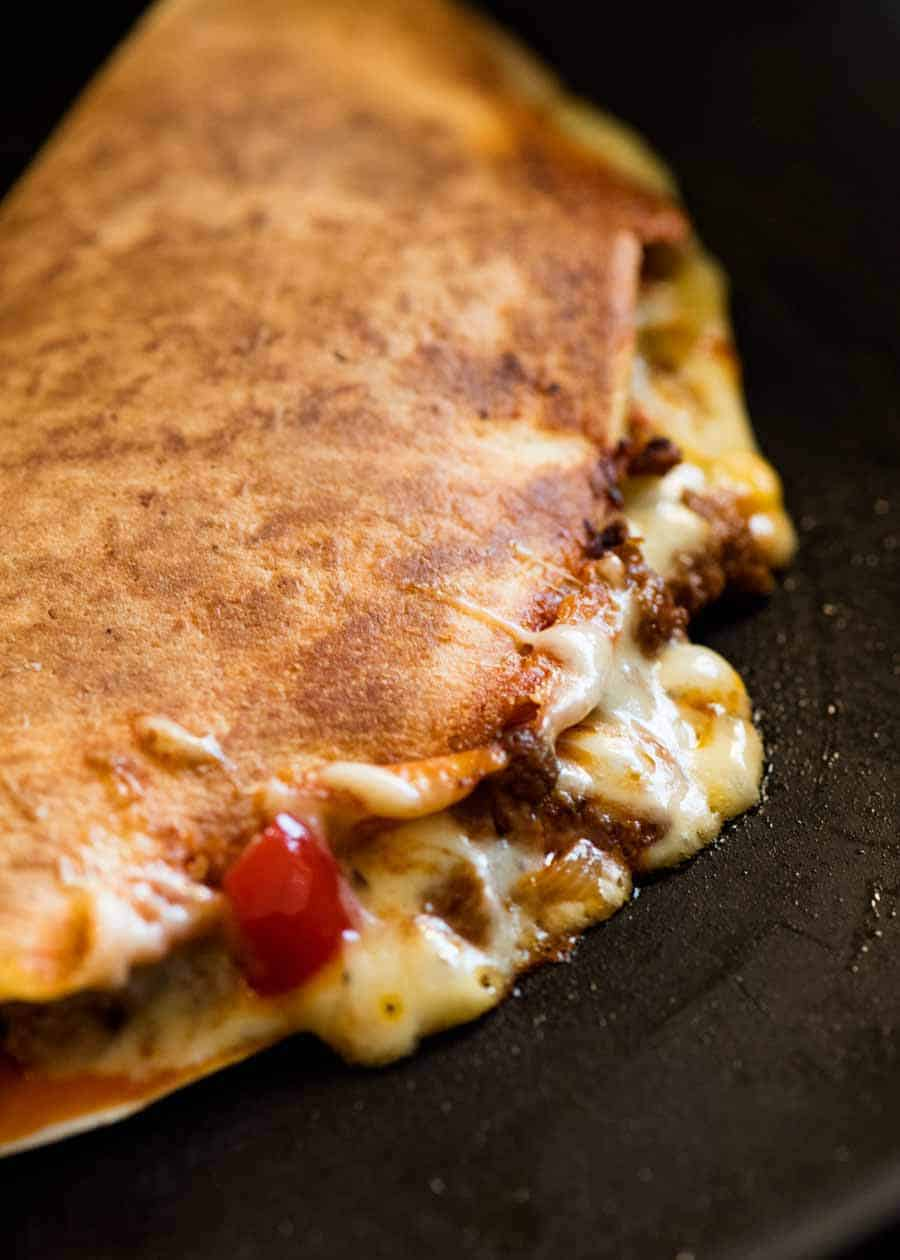 Close up of Quesadilla being cooked in a black skillet