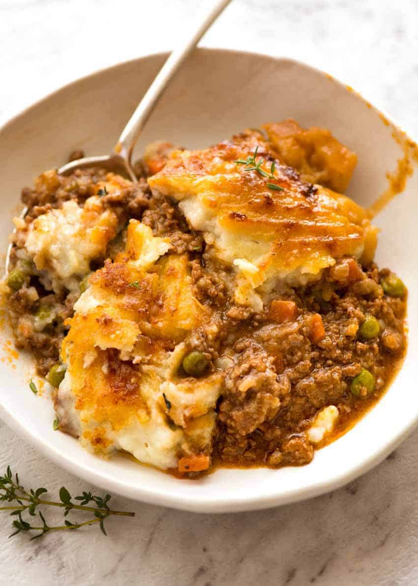 Shepherd's Pie in a rustic bowl with a spoon, ready to be eaten