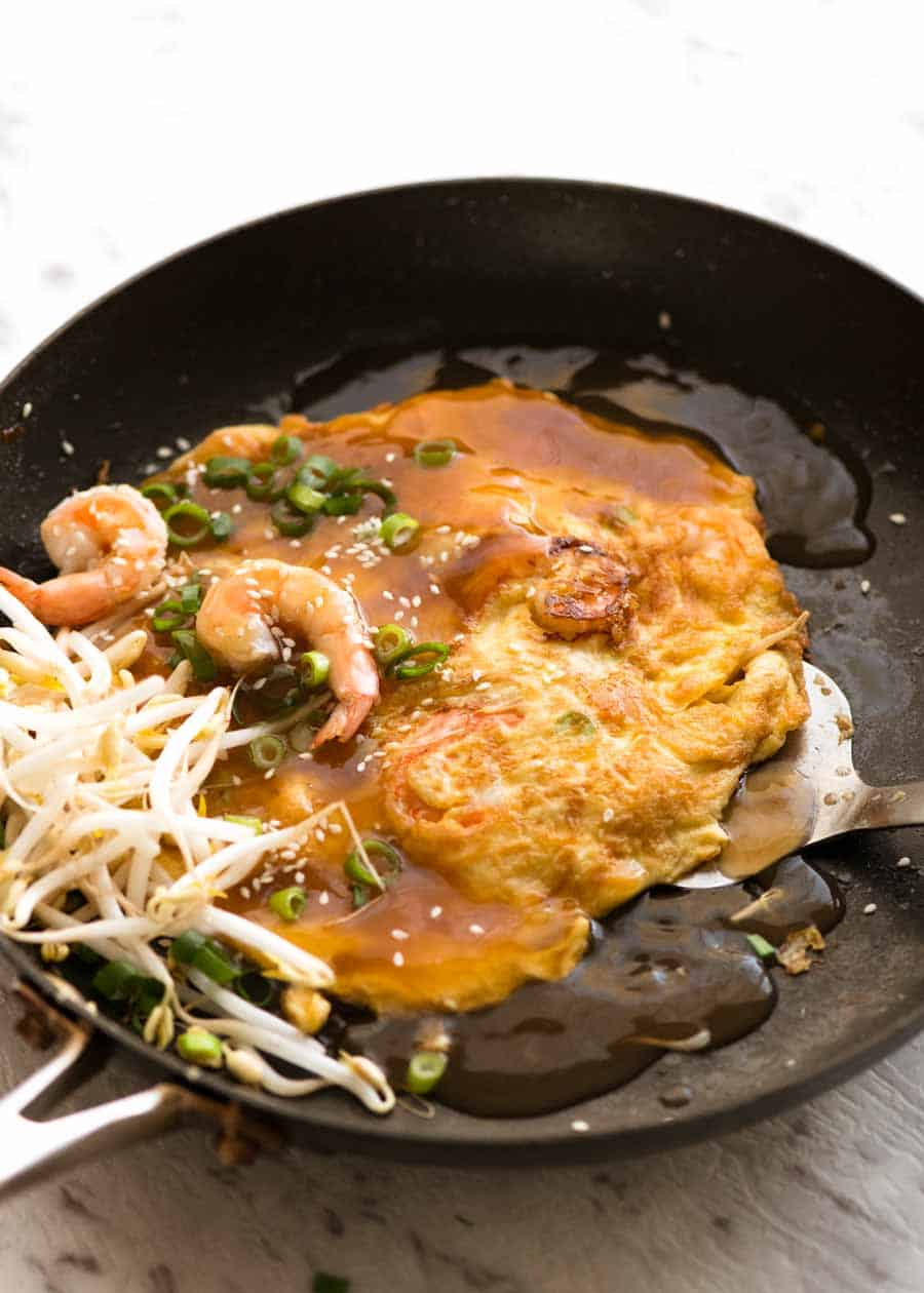 Photo of Egg Foo Young in a black skillet, fresh off the stove