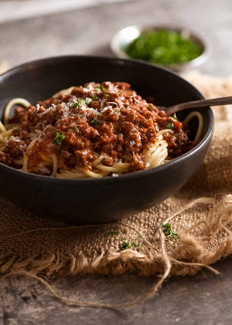 Meat sauce over spaghetti in a bowl, ready to be eaten