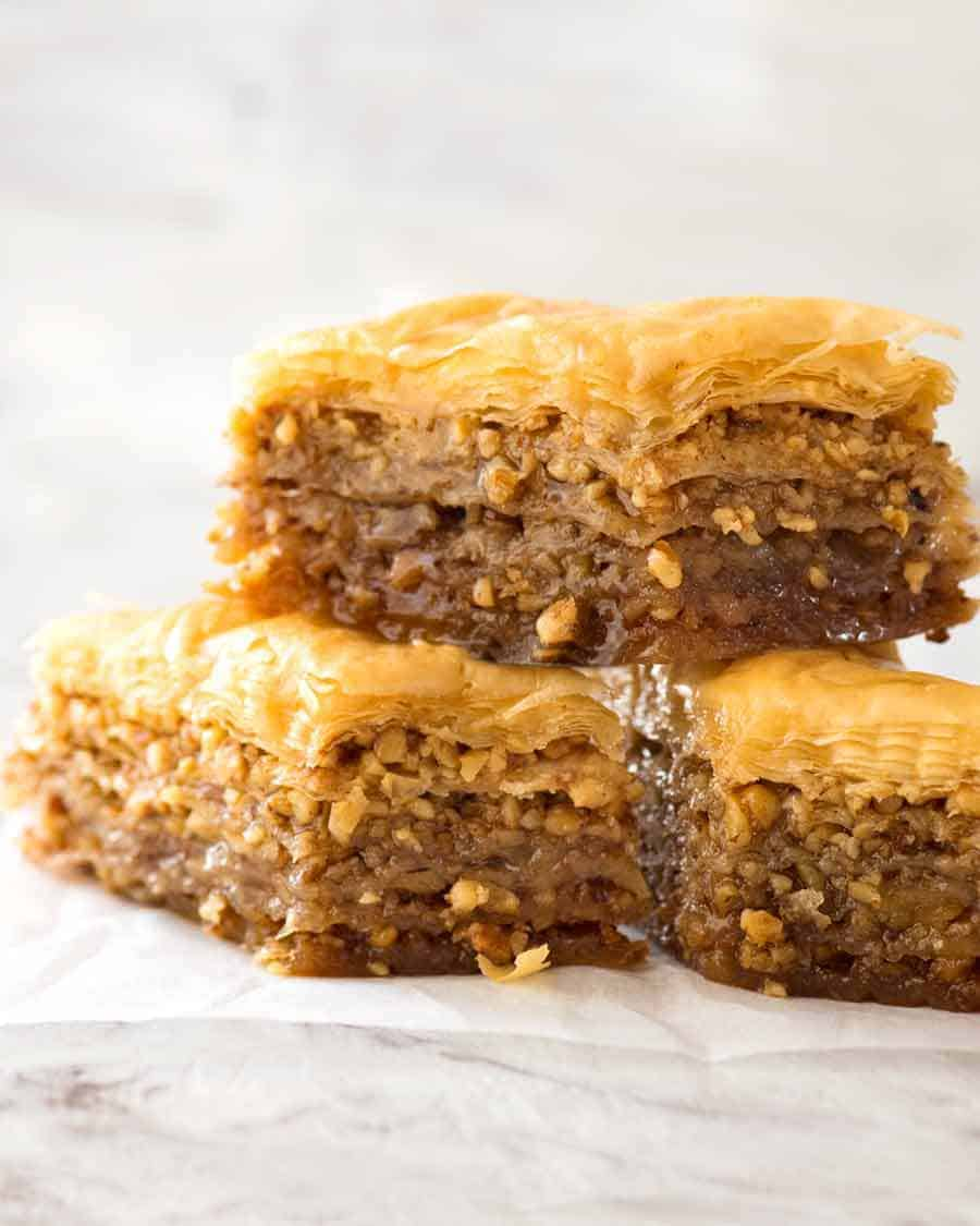 Close up of a stack of Baklava, dripping with honey syrup