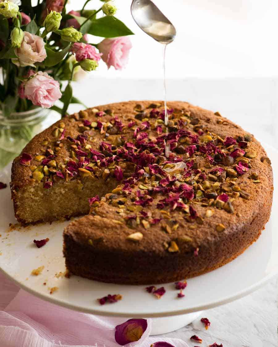 A beautiful Persian Love Cake (gluten free) made with semolina and almond meal soaked with a lemon syrup with a touch of optional rosewater.