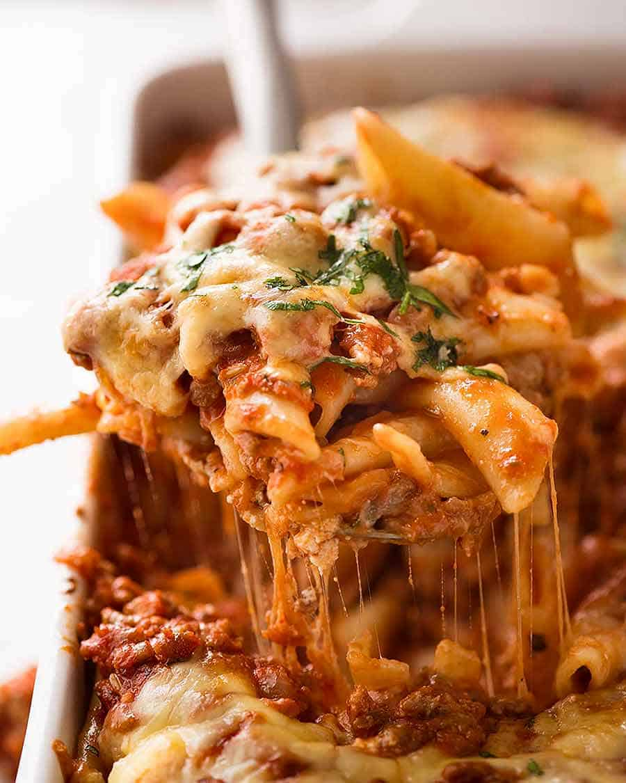 Baked Ziti in a white baking dish, fresh out of the oven