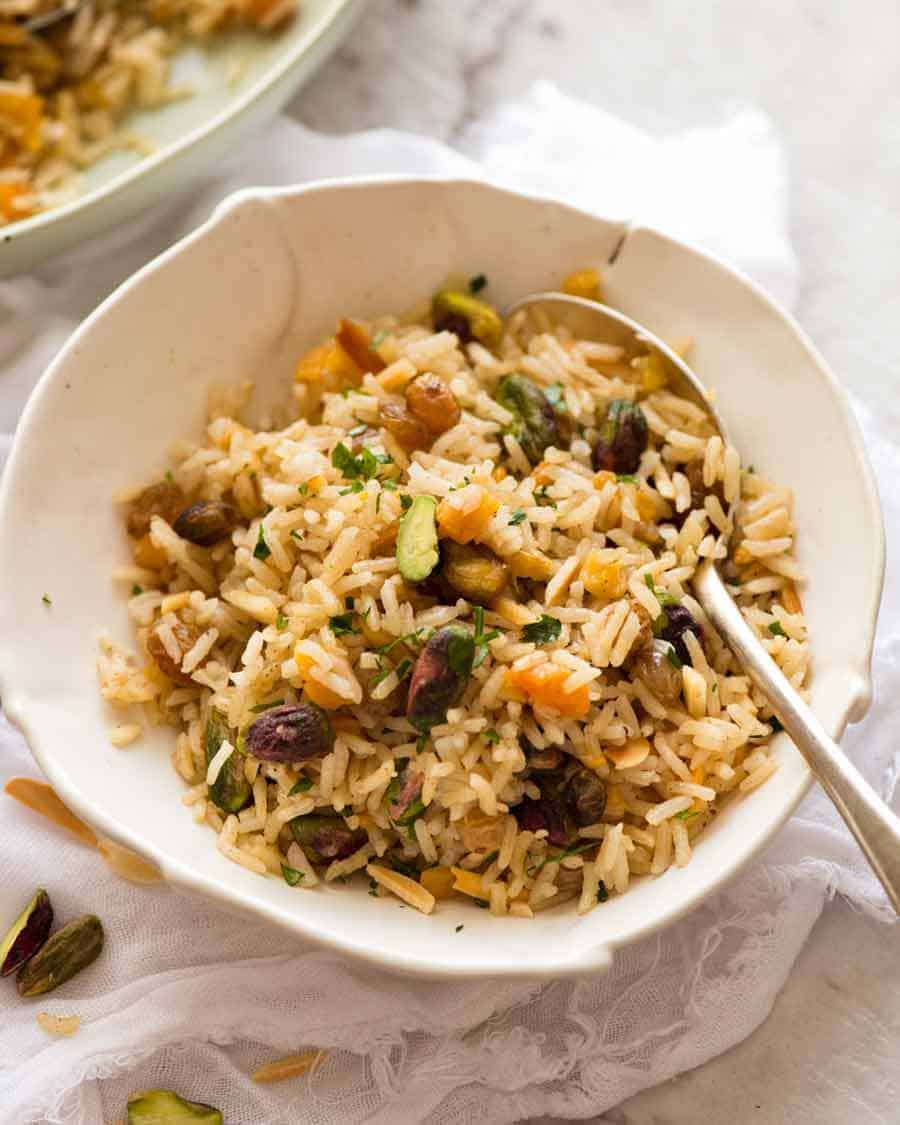 Rice Pilaf in a bowl with a spoon, ready to be eaten