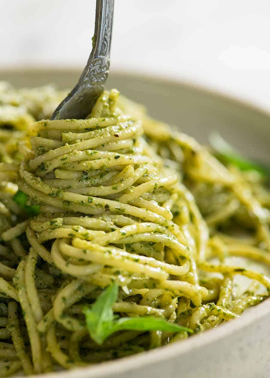 Fork twirling pesto pasta