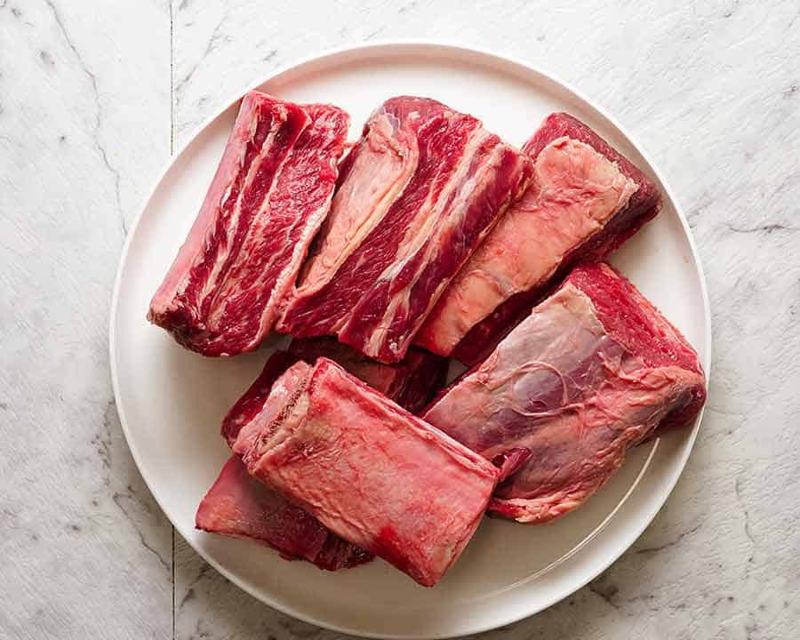 A plate with raw beef short ribs