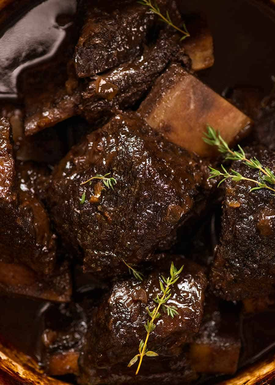 Close up of Slow Braised Beef Short Ribs in Red Wine Sauce in a pot, fresh out of the oven