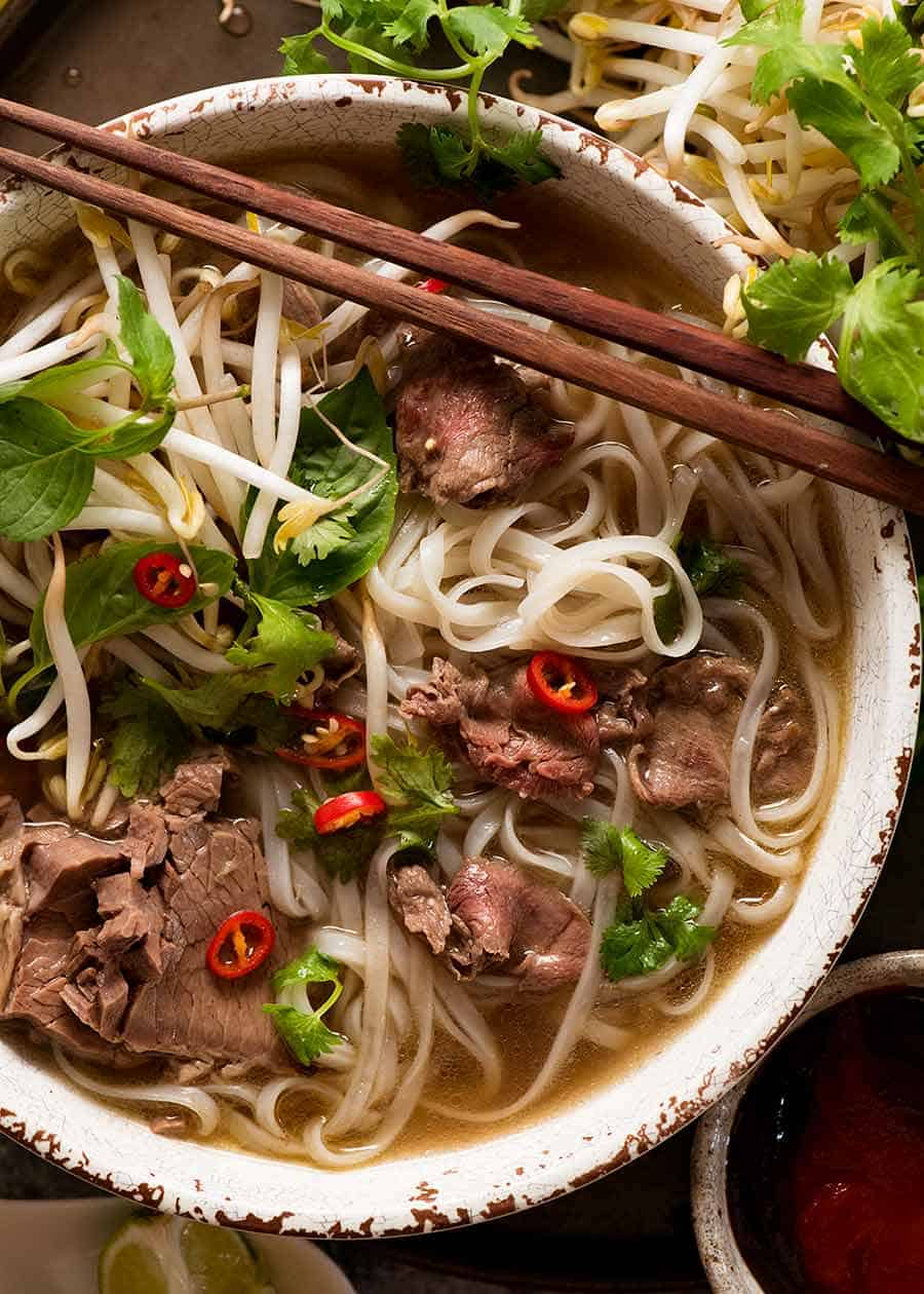 Beef pho recipe - overhead photo of pho in a bowl, ready to be eaten