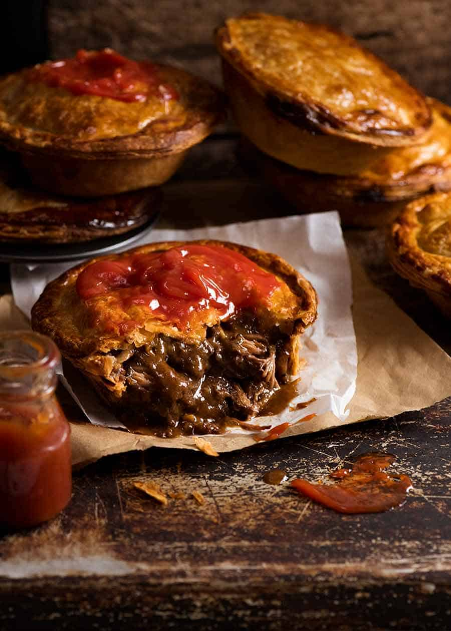 Australian Meat Pie cut open to show filling inside