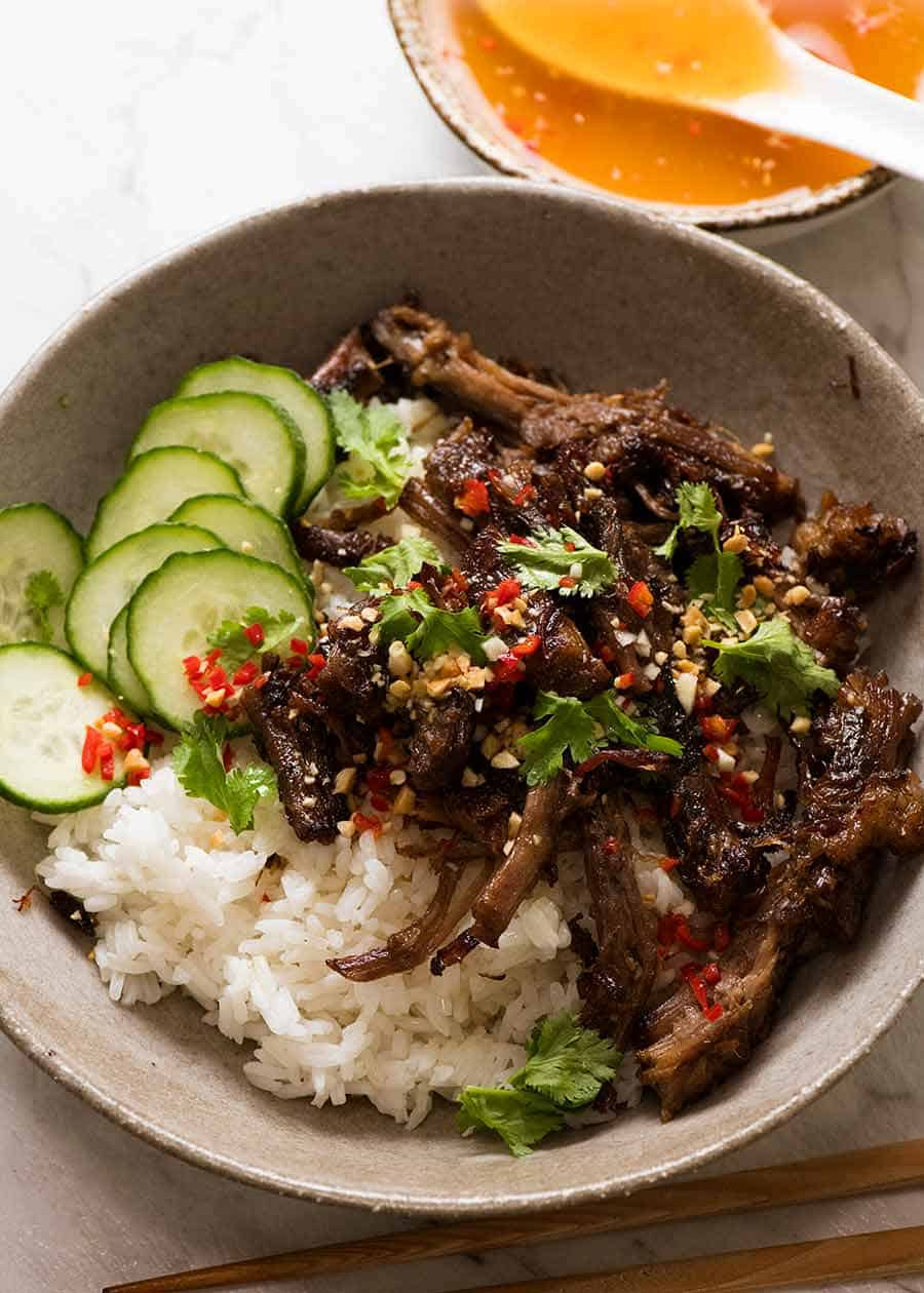 Caramelised Vietnamese Shredded Beef served over rice with lime wedges, cucumber, chilli and peanuts with Nuoc Cham sauce