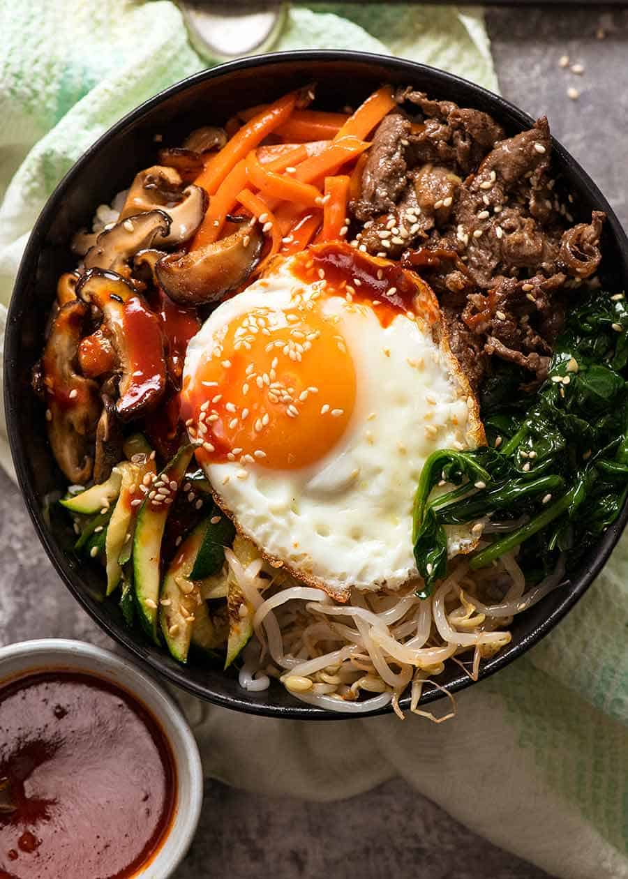 Overhead photo of Bibimbap, Korean Rice Bowl, ready to be eaten