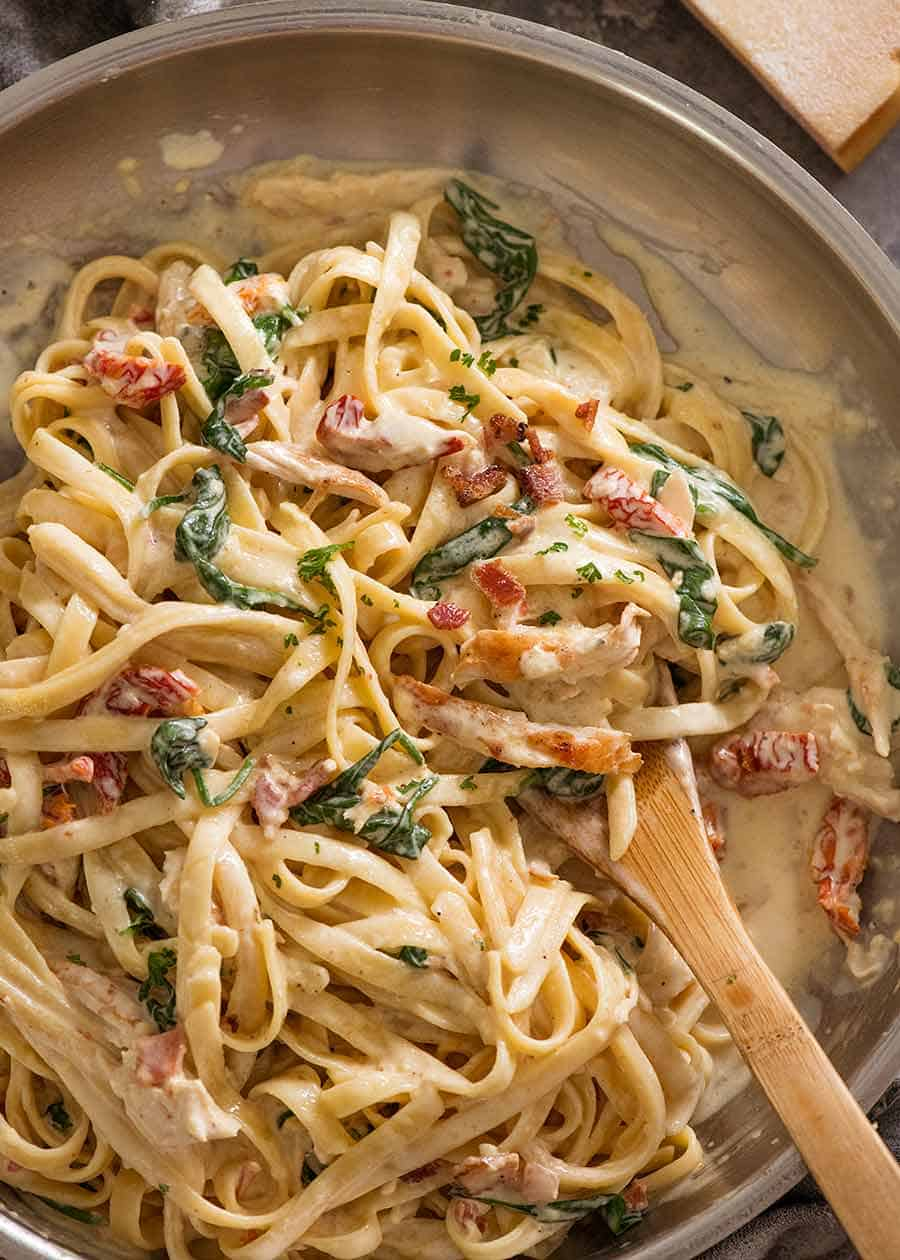 Overhead photo of Chicken Alfredo Pasta with sun dried tomato, spinach and bacon