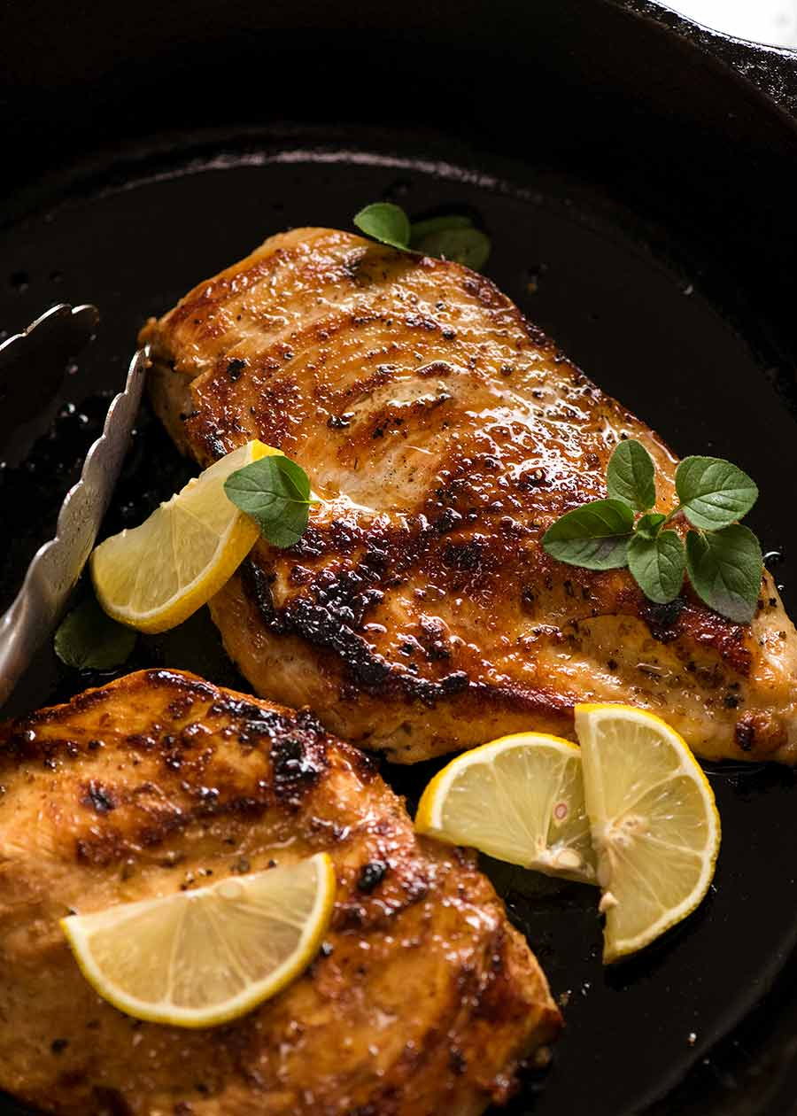 Cooked chicken breast (after marinated in Chicken Marinade) in black skillet , ready to be served