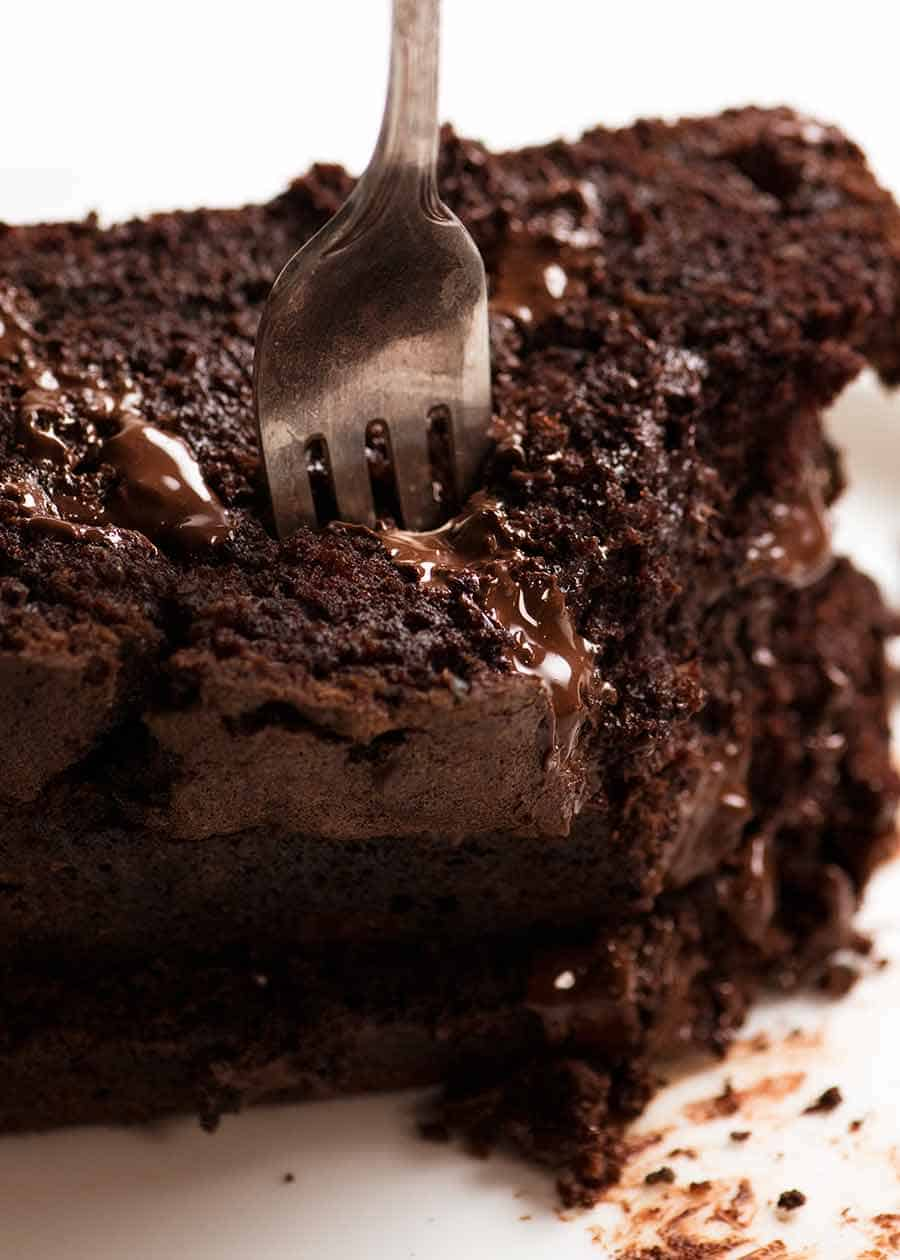 Close up of fork cutting into a stack of Chocolate Zucchini Bread slices