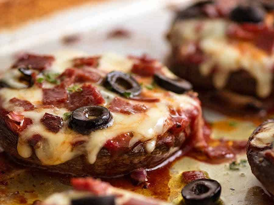 Close up of Pizza Stuffed Mushrooms with pepperoni, salami, olives and onion