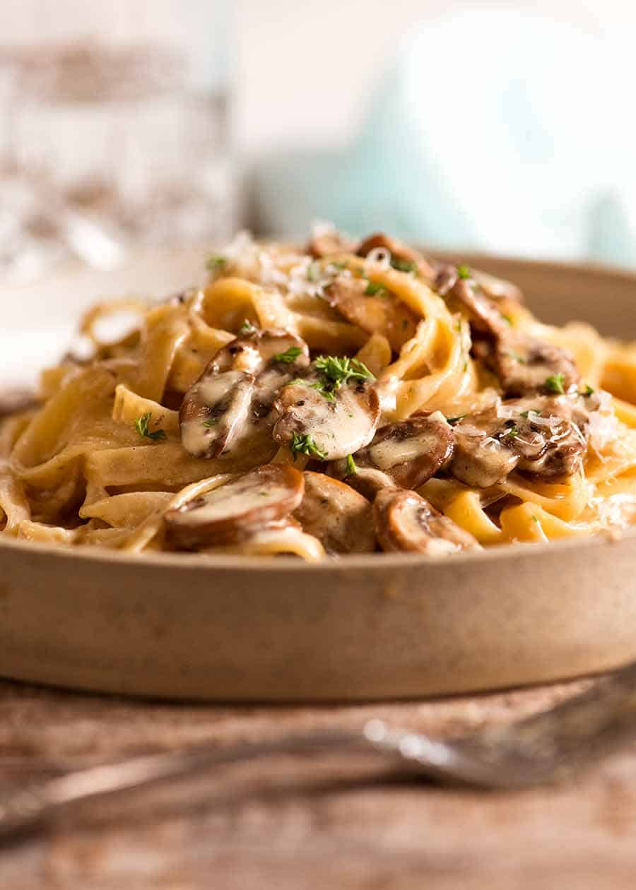 Creamy Mushroom Pasta on a rustic handmade plate, ready to be eaten