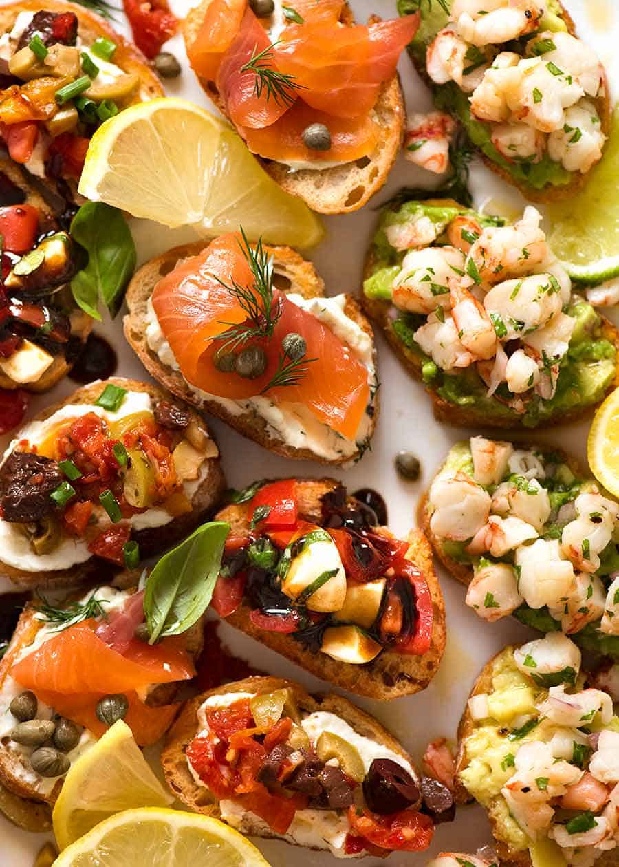 Serving platter filled with Crostini - Smoked Salmon, Shrimp Avocado, Mediterranean and Caprese