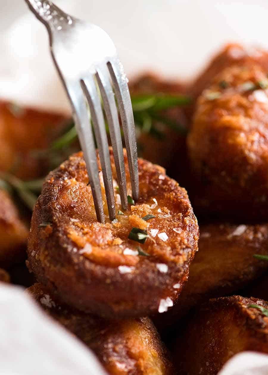 Close up of fork piercing a Duck Fat Roast Potato