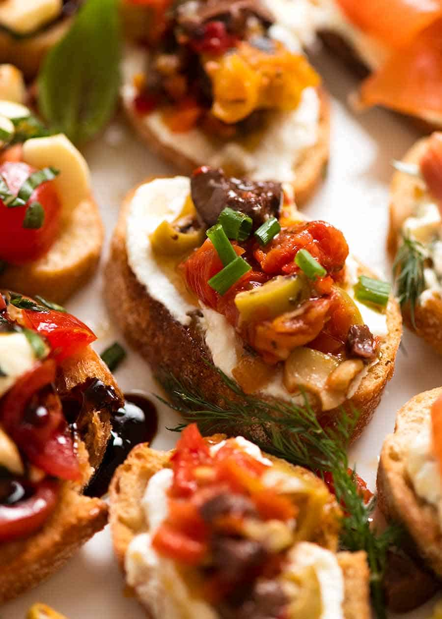 Close up of Mediterranean Crostini with olives, grilled peppers, marinated eggplant