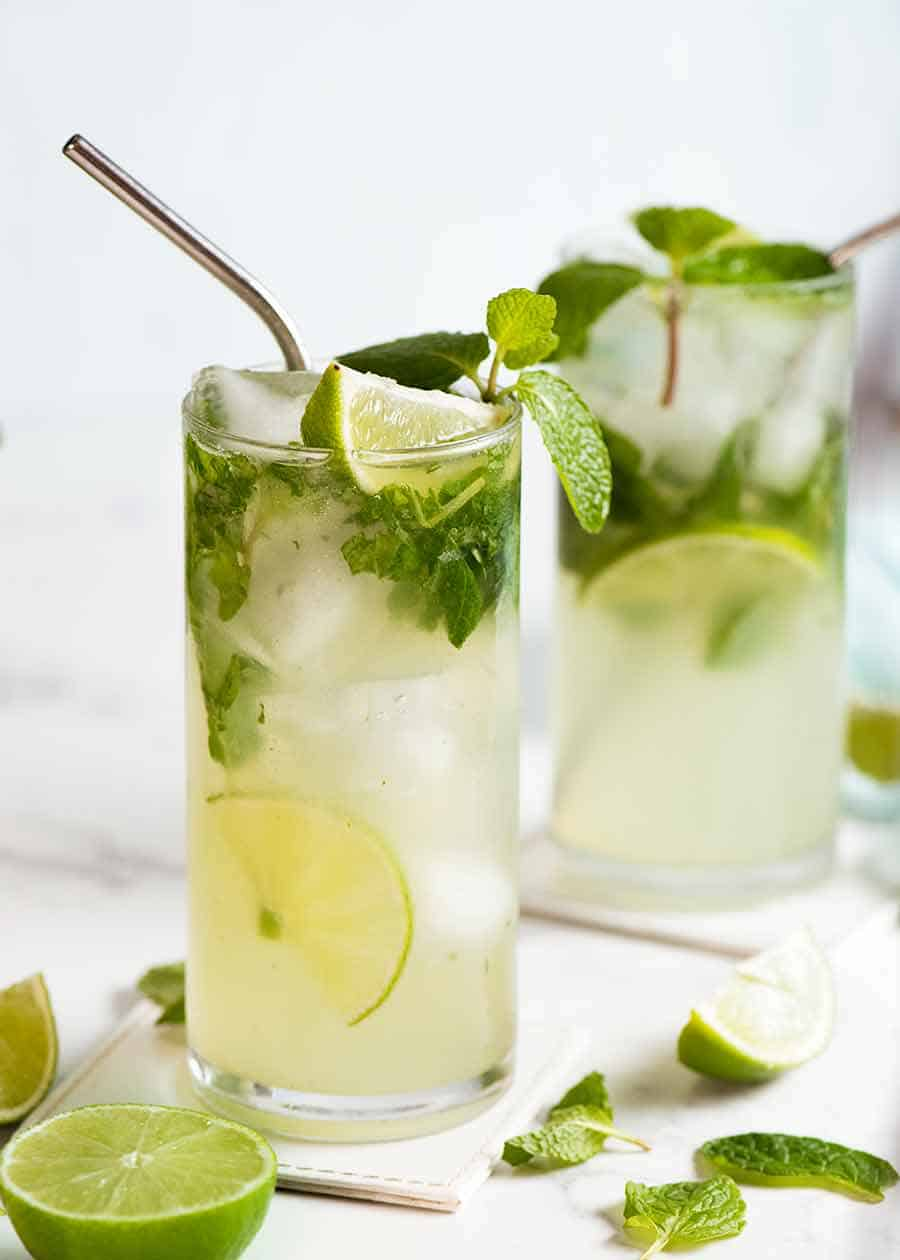 Two Mojitos in glasses, ready to drink