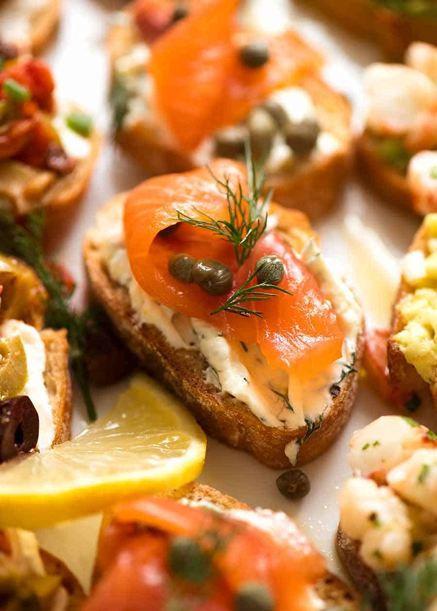 Close up of Smoked Salmon Crostini with cream cheese, dill, lemon and capers