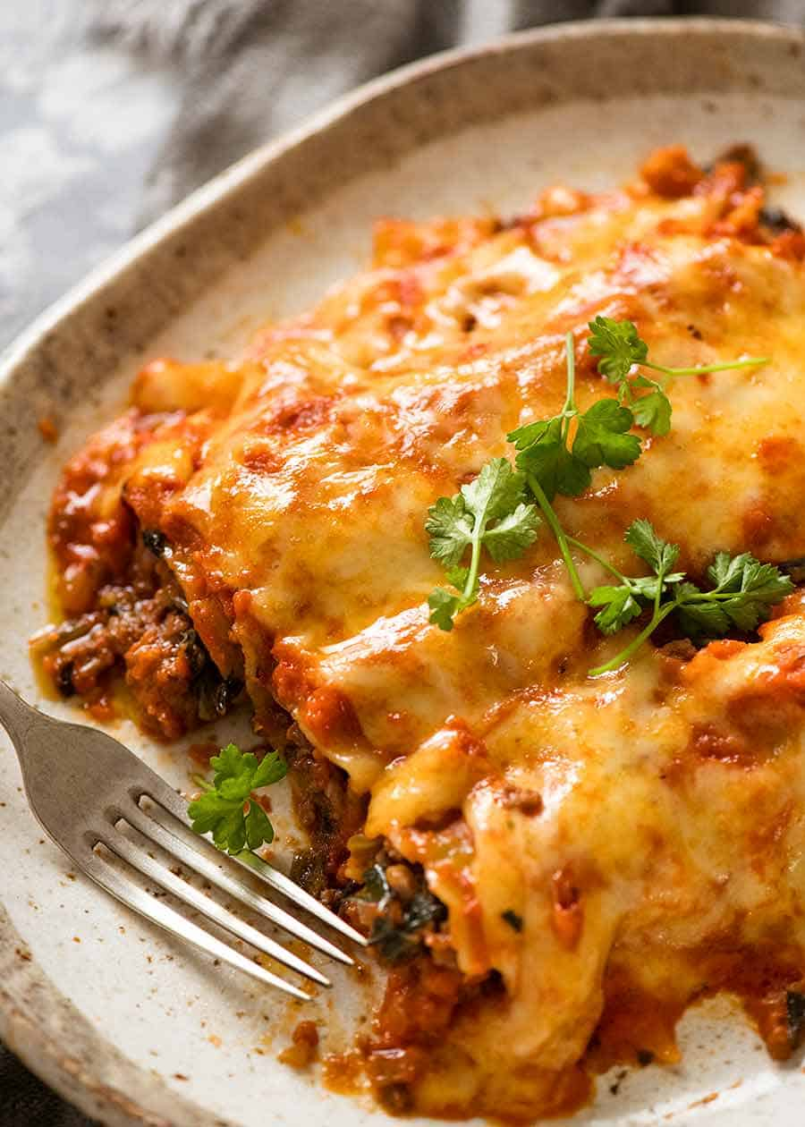 3 Spinach Beef Cannelloni on a plate, ready to be eaten